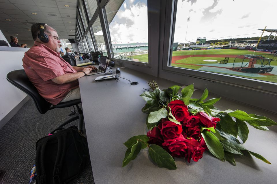Roses mark Nick Cafardo's spot in the press box at JetBlue Park, next to Nick's friend and colleague, Peter Abraham.