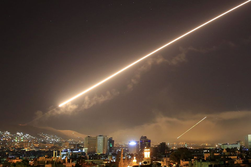 Surface to air missiles light up the sky over Damascus in the US attack on Saturday.