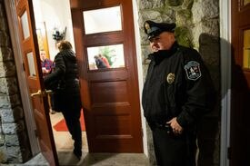 Lexington Police Officer Mike Barry was posted at the entrance during an interfaith service held at Hancock United Church Of Christ in Lexington.