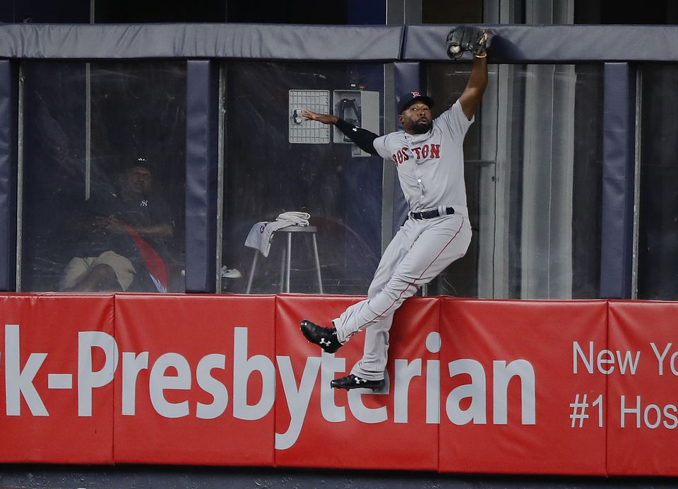 Jackie Bradley Jr. robs the Yankees' Aaron Hicks of extra bases during the Red Sox' rout of the Yankees on Saturday night.