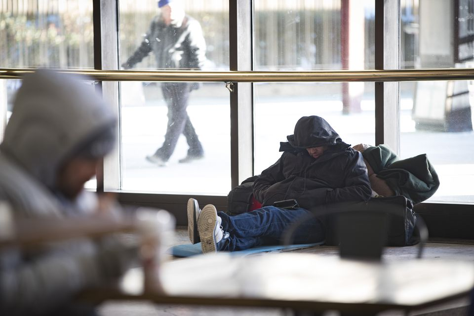 Homeless people sought refuge Monday in South Station's main atrium.