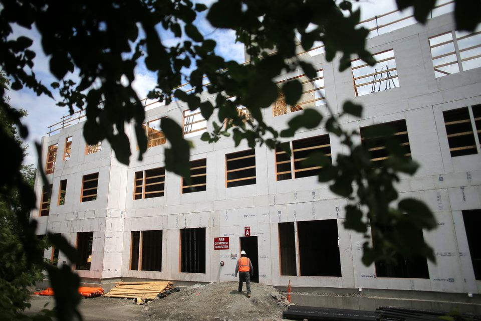 A big apartment complex is being built on Waltham's Cooper Street, the site of a building that burned down last summer.