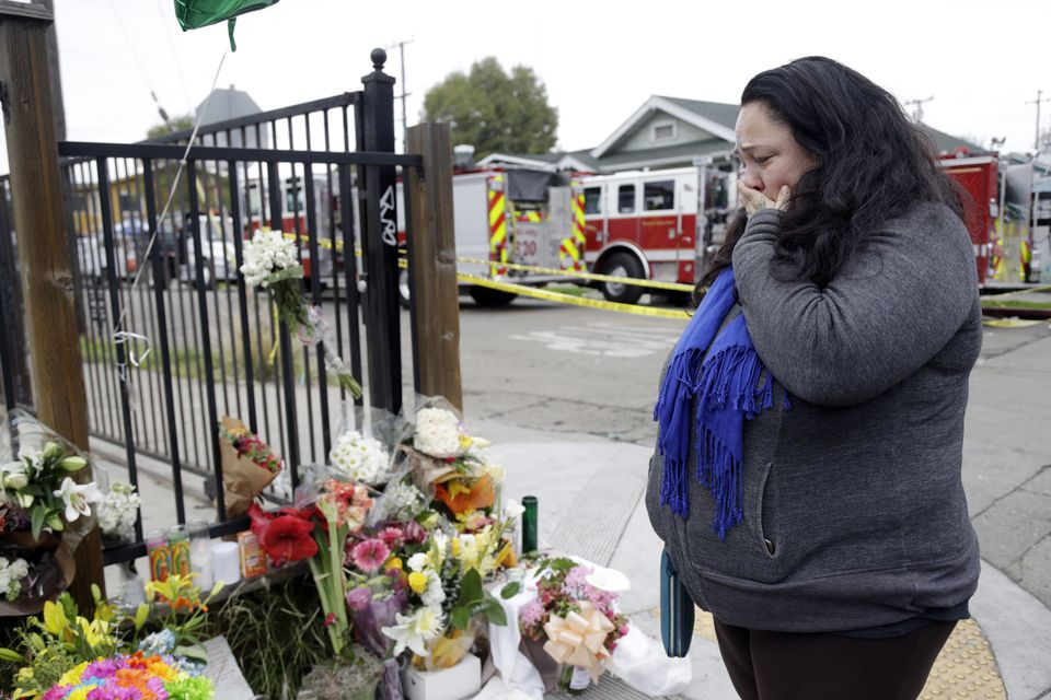 Danielle Boudreaux stood at a memorial near the site of the fire.