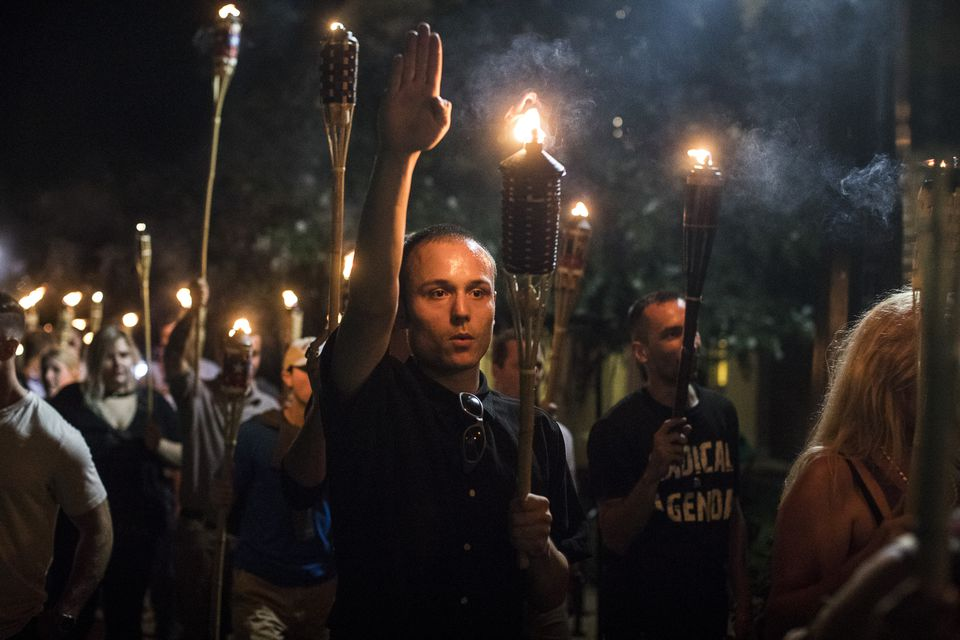 White supremacist groups march through the grounds of the University of Virginia on Aug. 11, 2017.