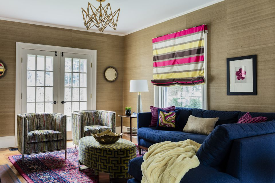 By introducing bright colors, different textiles, and a sectional sofa, interior designer Ana Donohue transformed the living room of a Newton Victorian into a space for the owners to formally entertain and casually hang out with family.