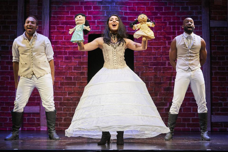 "Chuckie Benson, Ani Djirdjirian, and Datus Puryear in the Huntington Theatre Company's production of ""Spamilton: An American Parody."""