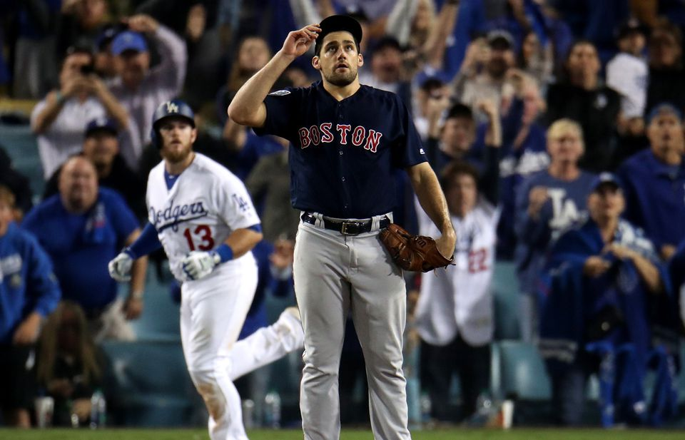 Red Sox pitcher Nathan Eovaldi watches Max Muncy's walk-off home run in the 18th inning of Game 3 of the World Series.