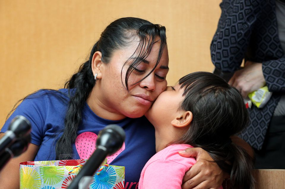 Angelica Rebeca Gonzalez-Garcia comforts her 8-year-old daughter, Sandy, during a press conference, after being reunited at Logan International Airport in Boston on Thursday.