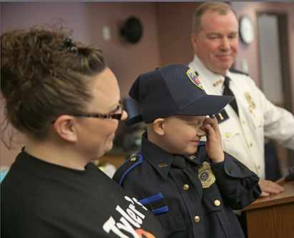 R I  boy battling cancer gets to be chief for the day - The Boston Globe