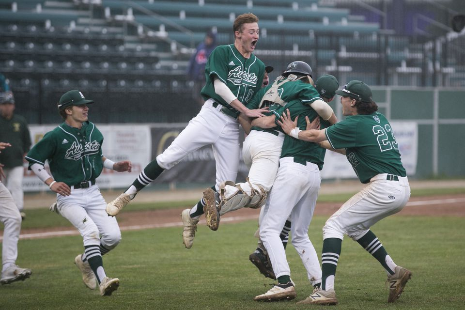 Austin Prep players celebrate after beating Taconic for the Division 3 crown.