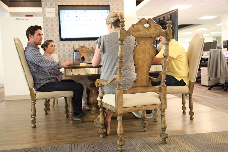 At Boston-based Wayfair, staff meetings often take place on furniture the company sells.