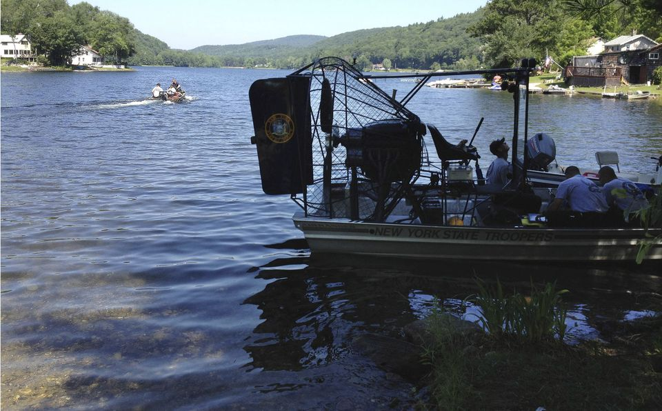 """Massachusetts and New York State Police dive teams headed out on Greenwater Pond to search for the body of James """"Jamie"""" Lusher on Tuesday."""