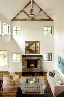 """Living room assets include a Danish modern coffee table by Henning Norgaard and a Madeline Weinrib """"Tulu"""" rug."""