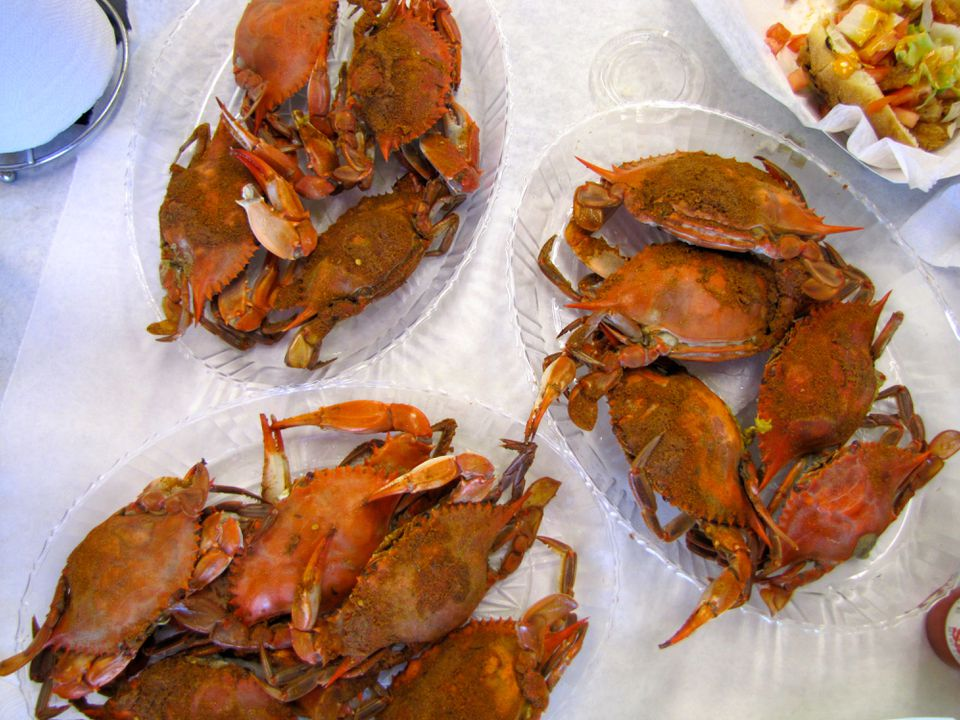Plates of cooked crabs.
