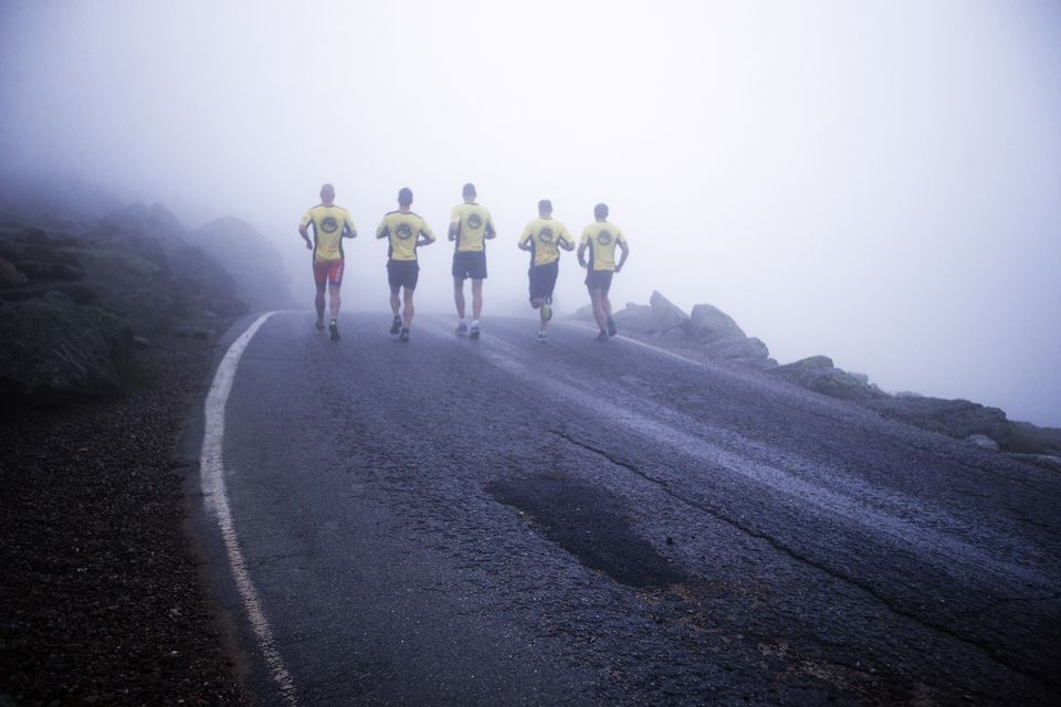 Four Navy SEALs and a Coast Guardsman got an early-morning start on misty Mount Washington as they ran a triathlon to benefit Camp Sunshine, a retreat for children with life-threatening illnesses.