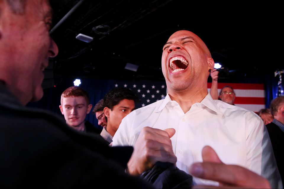 US Senator Cory Booker of New Jersey laughed while chatting with a supporter Saturday in Portsmouth, N.H.