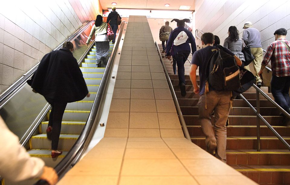 Commuters used the recently repaired escalator for the Red Line in South Station on Friday. Another escalator there, and one at the Route 128 station, remain out of order.