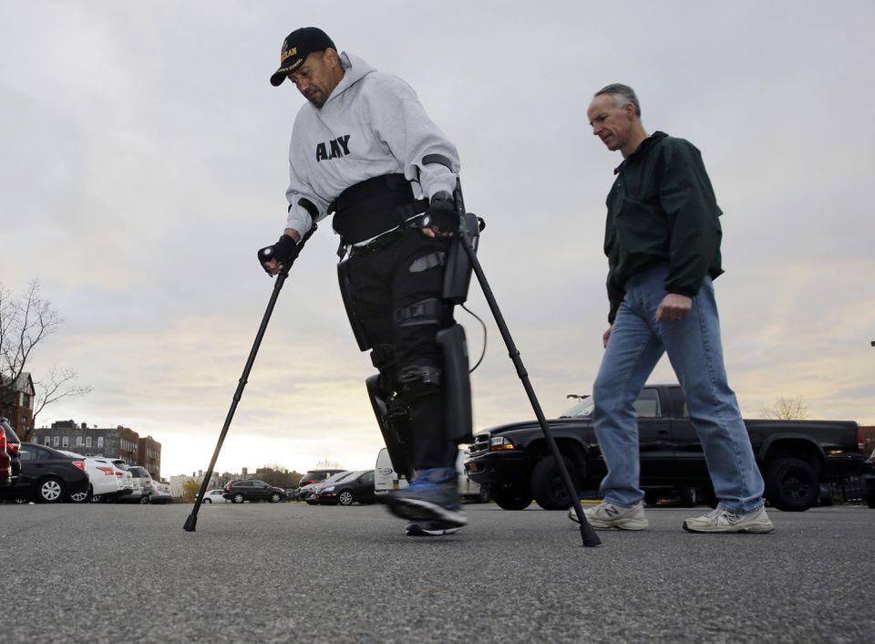 ReWalk Robotics service engineer Tom Coulter watched this week as Army veteran Gene Laureano walked.
