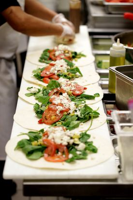 A wrap assembly line at Salvatore's.