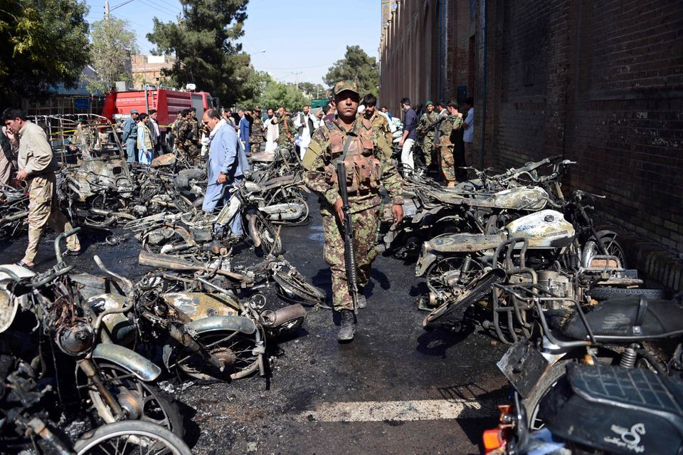 Afghan security personnel arrive at the site of a motorcycle bomb explosion in front of the Jami Mosque in Herat on June 6.
