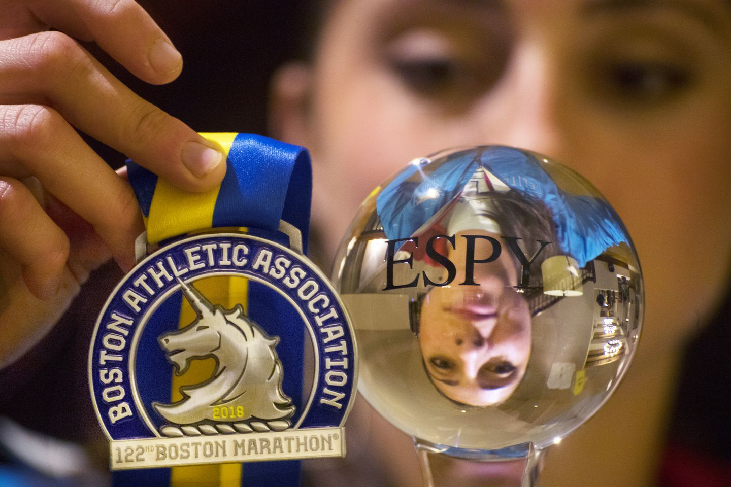 Sellers with her Boston Marathon medal and an honorary ESPY she won for her achievement.
