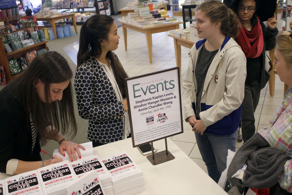 Stephanie Kaplan Lewis (left) and Annie Wang of Her Campus chat with Sarah O'Connor, 16, at the Prudential Center Barnes & Noble.