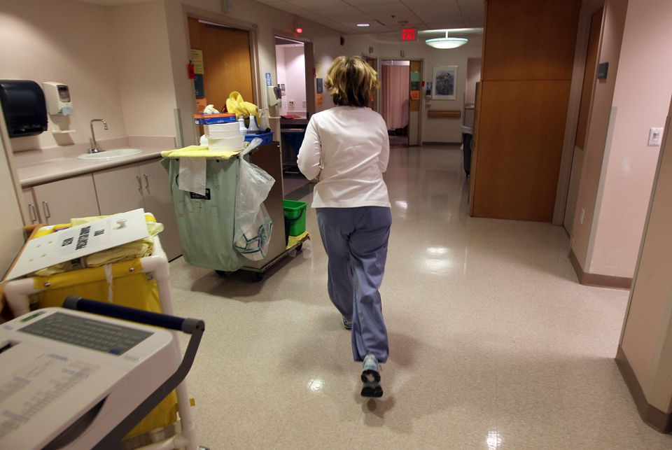 A nurse runs during her shift at the Clinic Center at Beth Israel Deaconess Hospital West Campus. The Supreme Judicial Court ruled Monday in favor of a ballot petition about nurse staffing levels in Massachusetts that is backed by the Massachusetts Nurses Association.