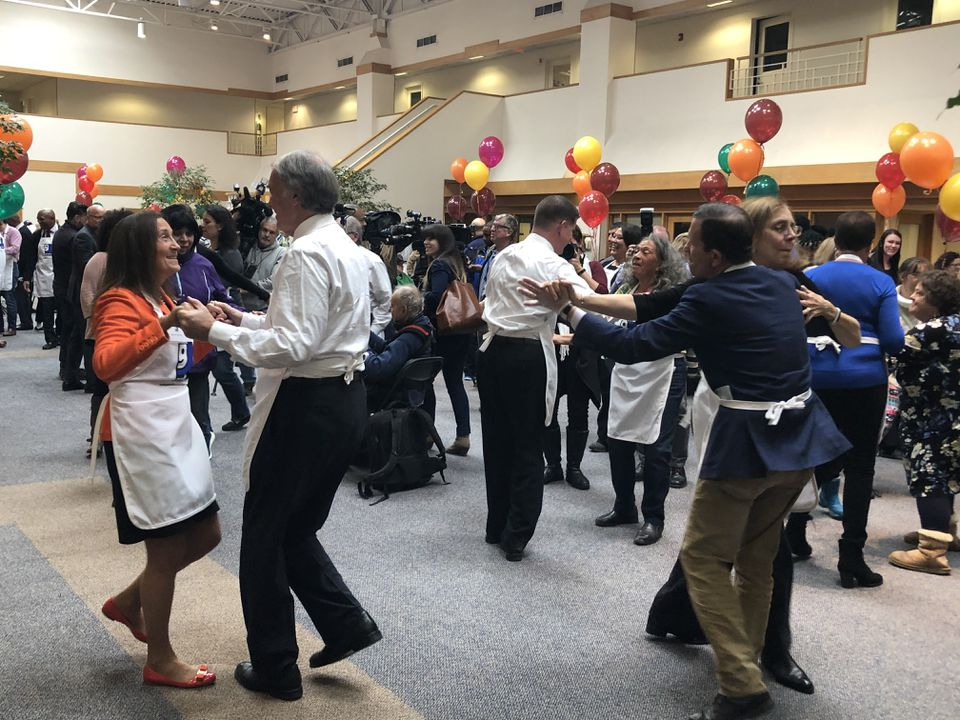 US Senator Edward M. Markey cut a rug with State Treasurer Deb Goldberg (in orange) at the event, with Mayor Martin J. Walsh (background, white shirt) and other volunteers.