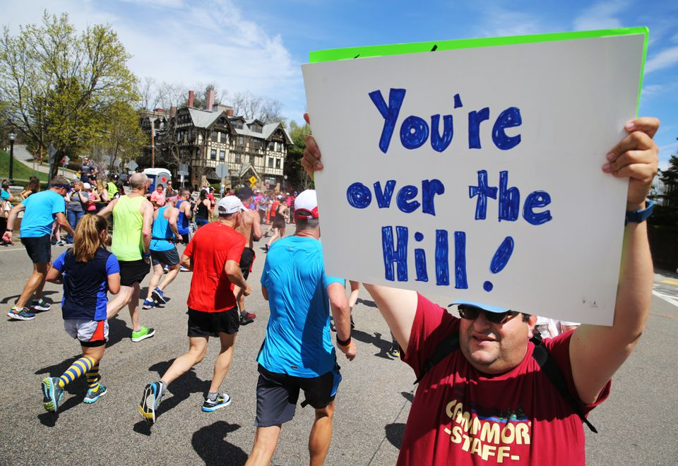 Chris Teager of Mont Clare, N.J., offered support to runners at Heartbreak Hill.