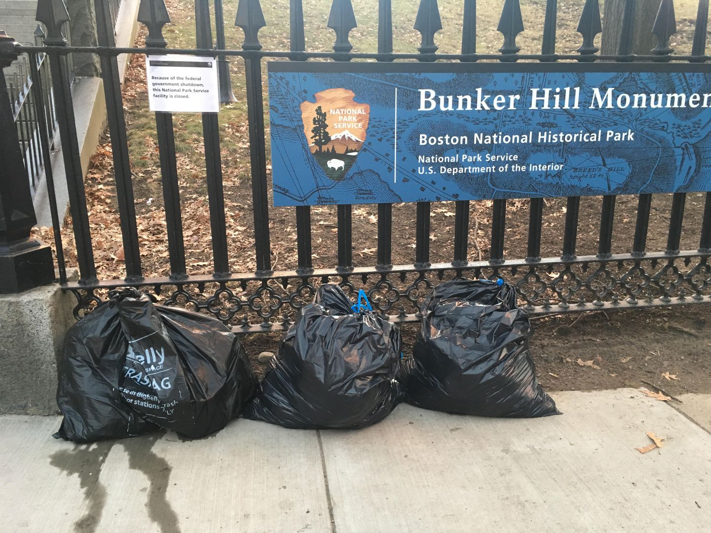 Trash left by receptacles at the Bunker Hill Monument.
