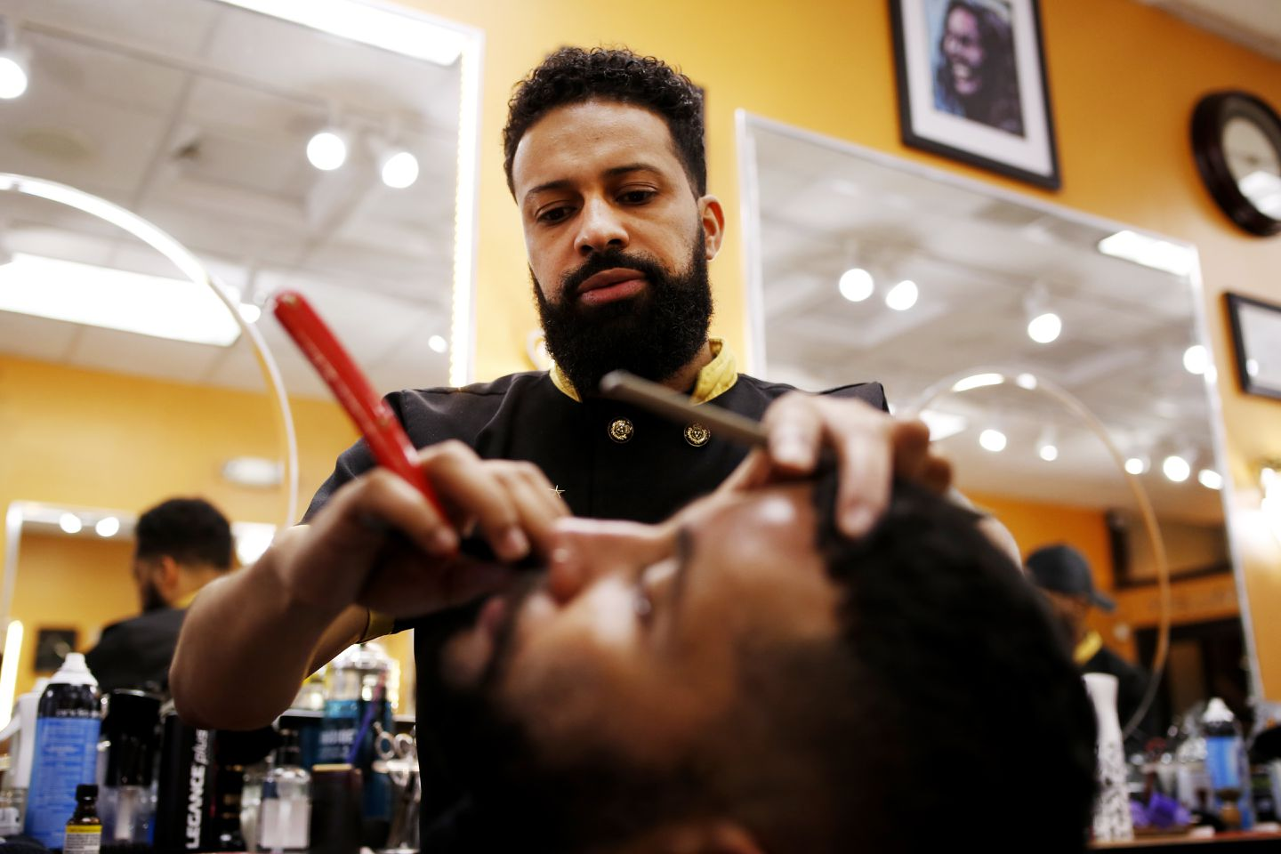 Lex Andre Daluz, owner of Marvelous Cuts, shaved Amalex Veiga's beard.