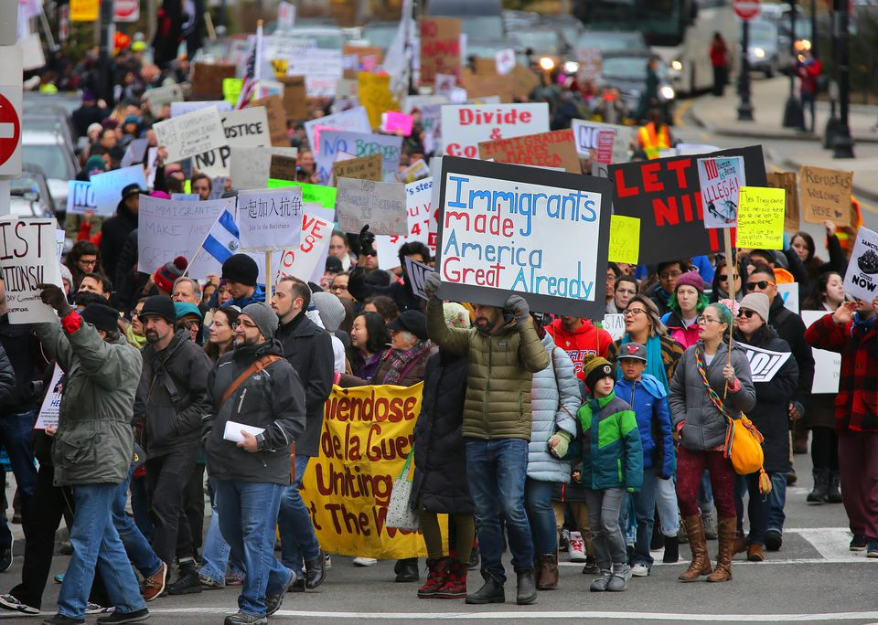 Protesters walked Saturday from Chinatown to the State House in a demonstration against President Trump's immigration order.