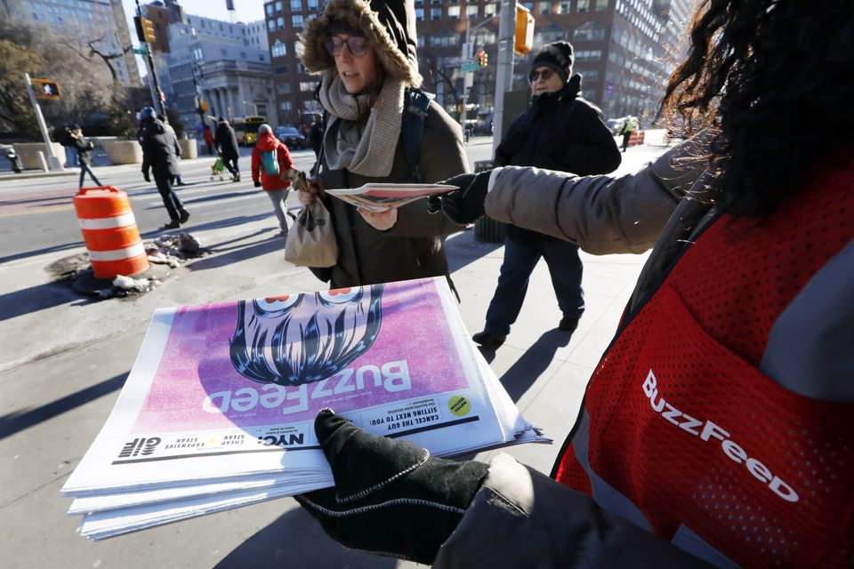 Camila Marte distributed copies of a BuzzFeed newspaper at a subway station near New York's Union Square, Wednesday.