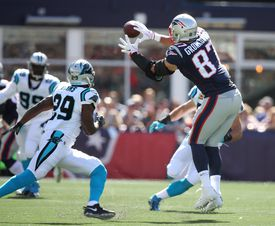 Rob Gronkowski hauls in a pass for a first down in the first quarter.