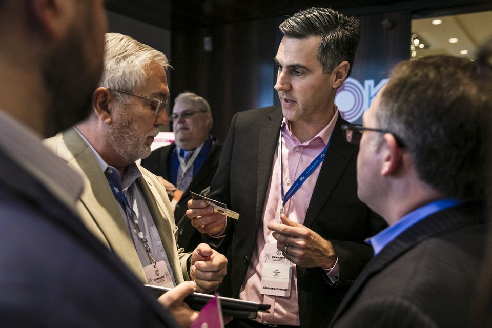 """Curaleaf chief executive Joseph Lusardi (center), seen at a presentation in Miami in January, said, """"I am absolutely confident that the transaction we file with the regulators will be compliant with state law."""""""
