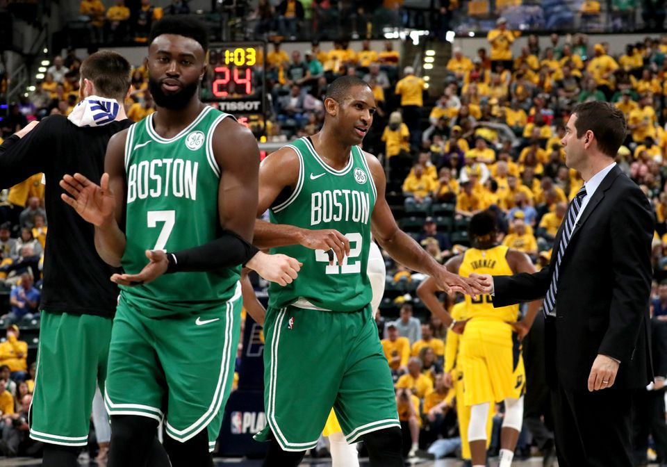 Celtics coach Brad Stevens greets Al Horford (42) and Jaylen Brown (left) as time wound down in Game 4.