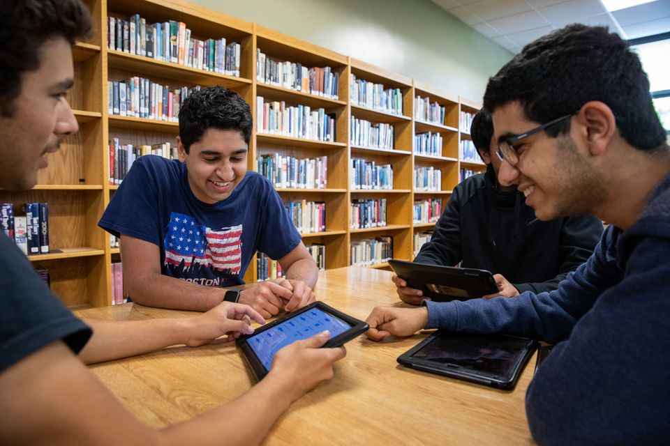 Senior Sabeer Narula (second from left) discusses an upcoming calculus exam with his friends (from left) Joseph Rios, Aashish Achanta, and Neville Hiramanek at Archbishop Mitty High School in San Jose, Calif.