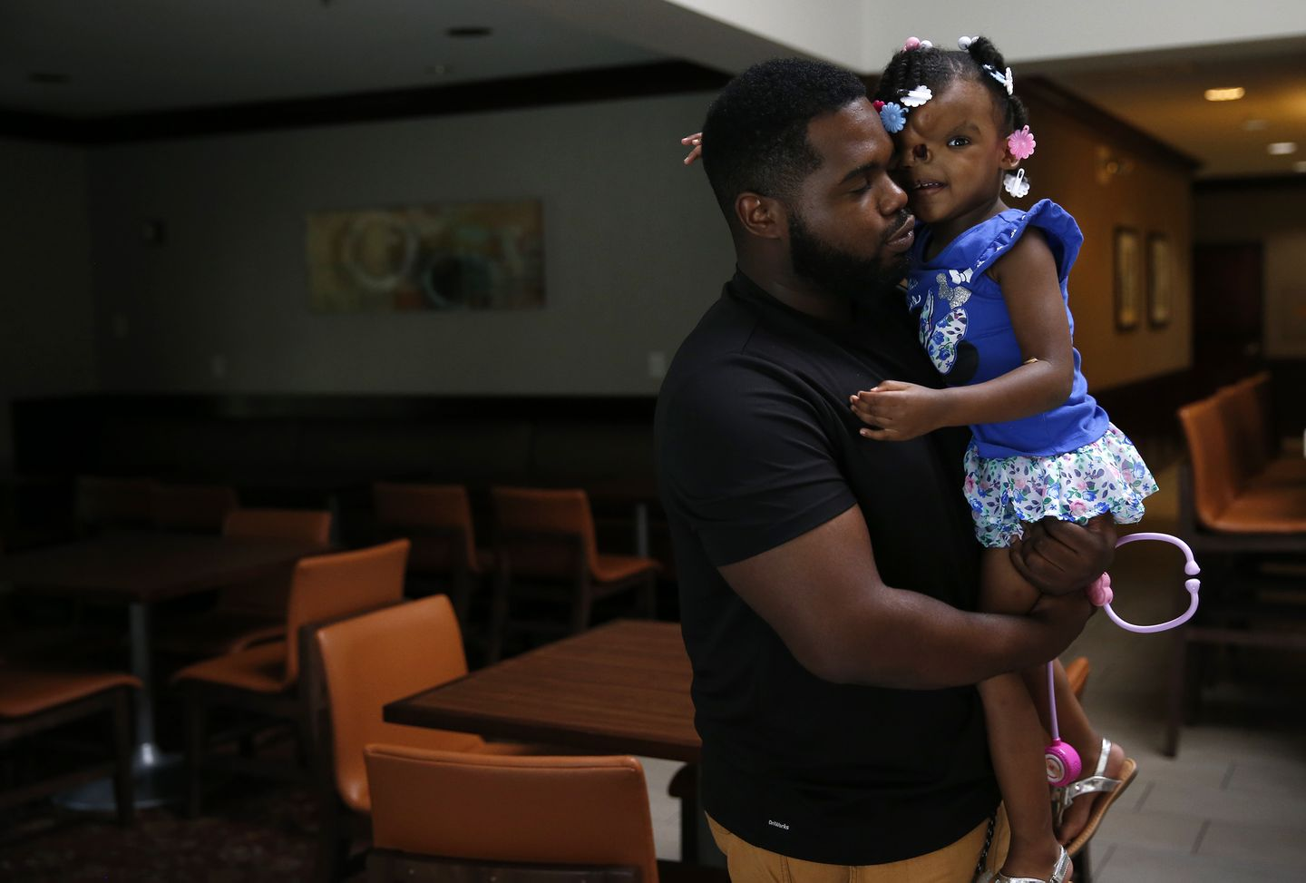 Quantrel Alford held Zoey in their hotel in Waltham the day before her surgery.