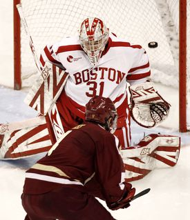 BC's Tommy Cross puts a backhander past BU goalie Kieran Millan early in the second period for the deciding goal.