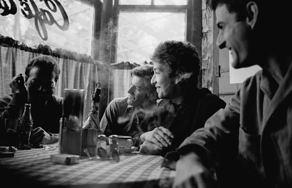 Bob Dylan with friends at Café Espresso in 1964.