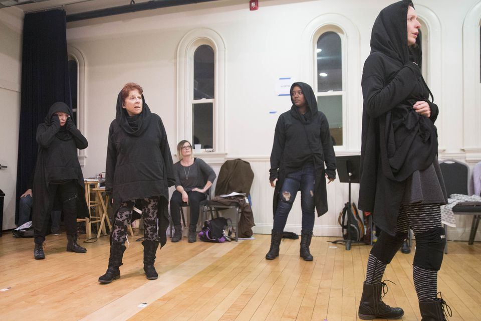 """Bryn Boice (seated) directs a rehearsal of """"Julius Caesar"""" with (from left) actors Marya Lowry, Bobbie Steinbach, Jade Guerra, and Marianna Bassham."""