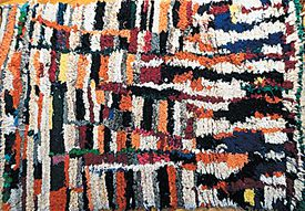 A carpet of wool and recycled clothing by Zahra Ait Eshu.