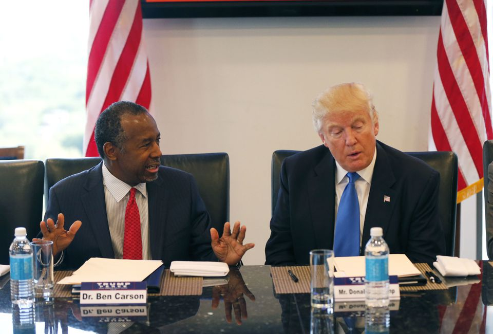 Dr. Ben Carson (left) and Donald Trump at a roundtable meeting with the Republican Leadership Initiative on Aug. 25.