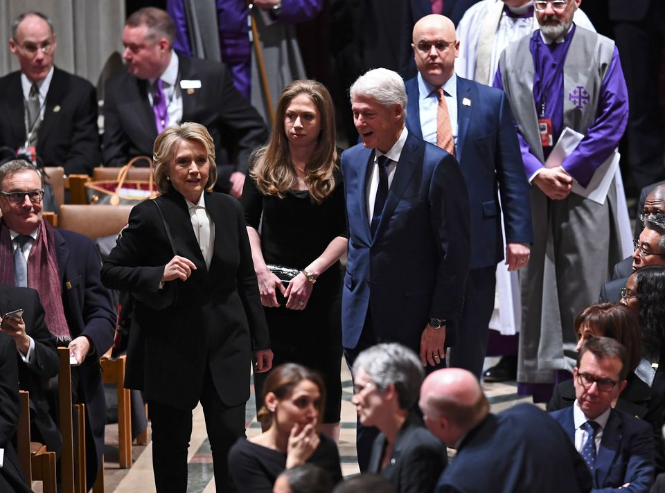 Former President Bill Clinton, former secretary of state Hillary Clinton, and daughter Chelsea Clinton (center).