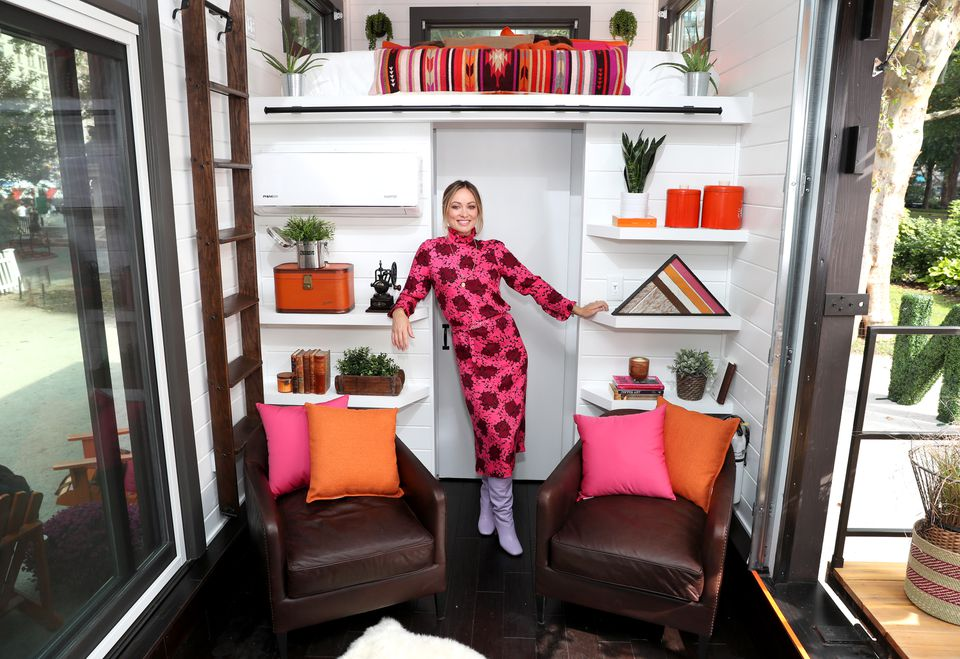 """Actress Olivia Wilde helps bring the slogan """"America Runs On Dunkin'"""" to life at the Home That Runs on Dunkin', powered by recycled coffee grounds, on Oct. 2, 2018 in New York City. It is now, temporarily, in Nahant."""