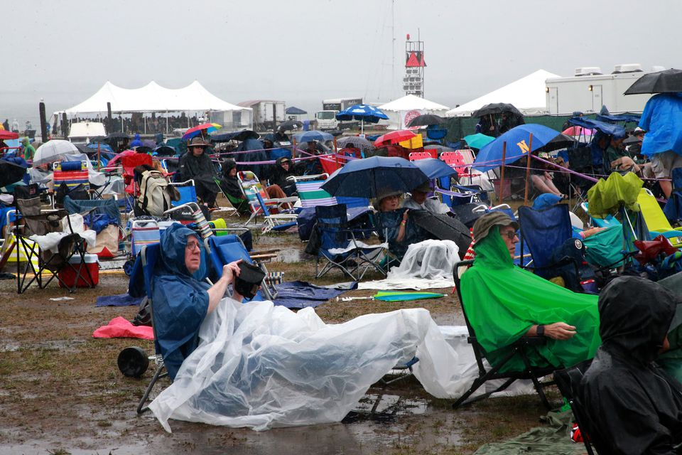 Fans sat in hours of rain at the Newport Jazz Festival on Saturday.
