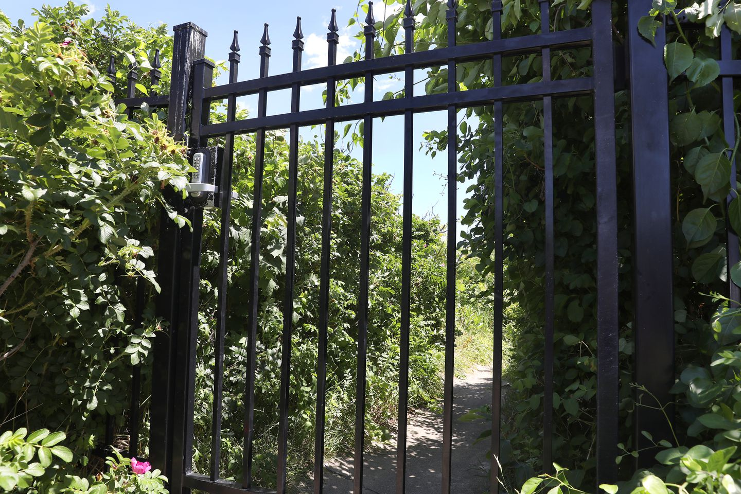 A homeowner installed this coded gate, dubbed the Hate Gate, on Kent Avenue to limit access to the beach.