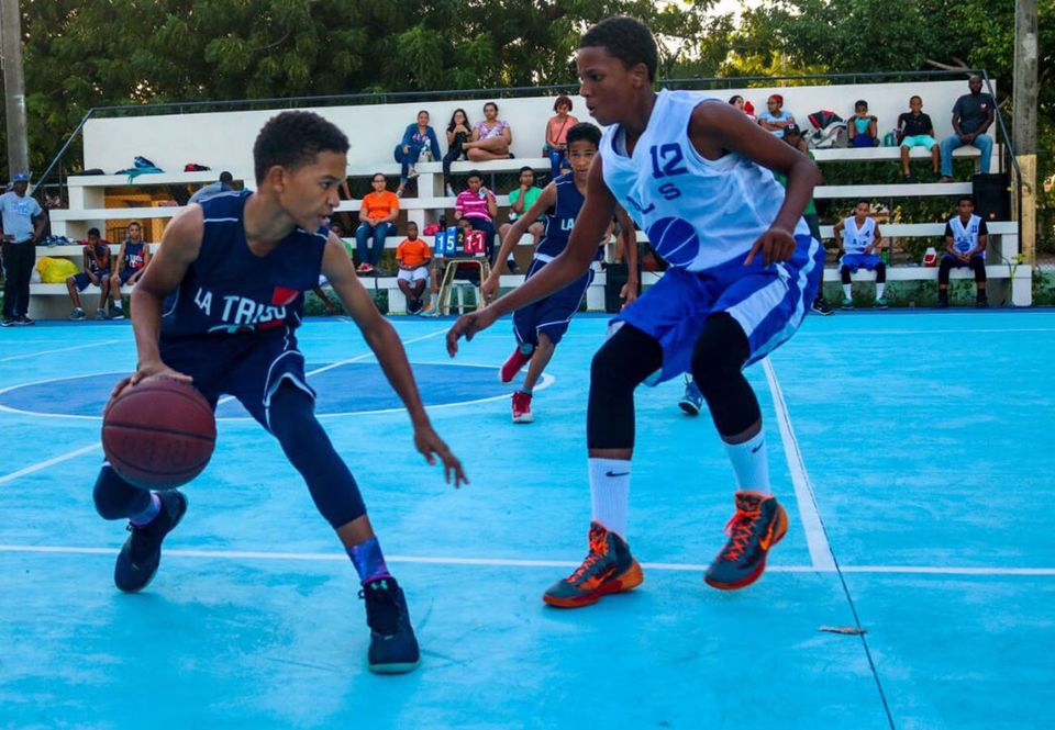 Young Dominican basketball players  on their new court.