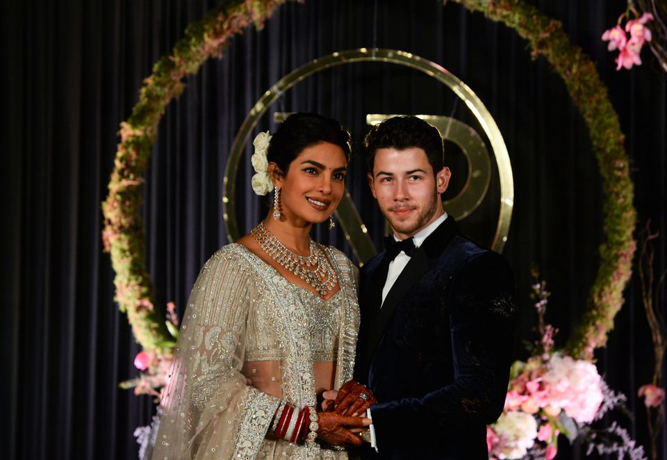 The couple posed for a photograph during a reception in New Delhi on Dec. 4.