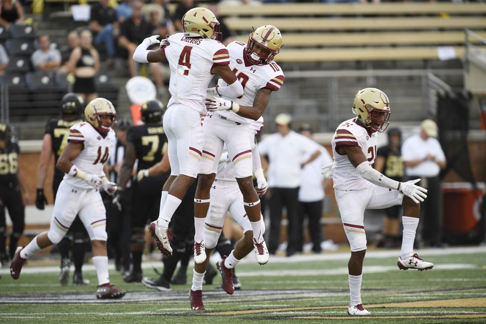 Hamp Cheevers (4) celebrates with BC teammate Brandon Sebastian after Cheevers' first-half interception at Walke Forest Sept. 13.